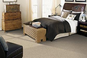 Bedroom scene with tan Softique carpet